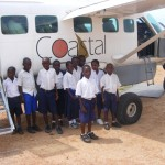 Schoolchildren in front of plane