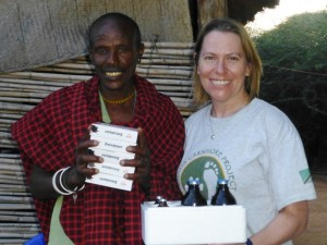 RCP Director Amy Dickman presents Mzee Hategeda, a Barabaig man from Kitisi, with his subsidised veterinary medicines. He is the first beneficiary of the programme.